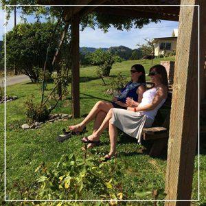 women drinking wine outdoors